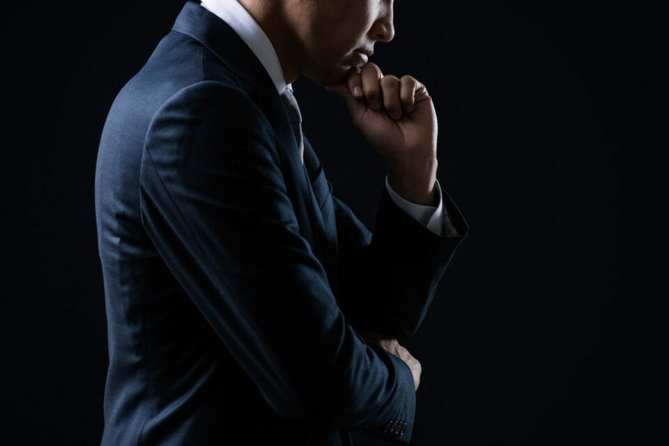 Businessman thinking about something seriously